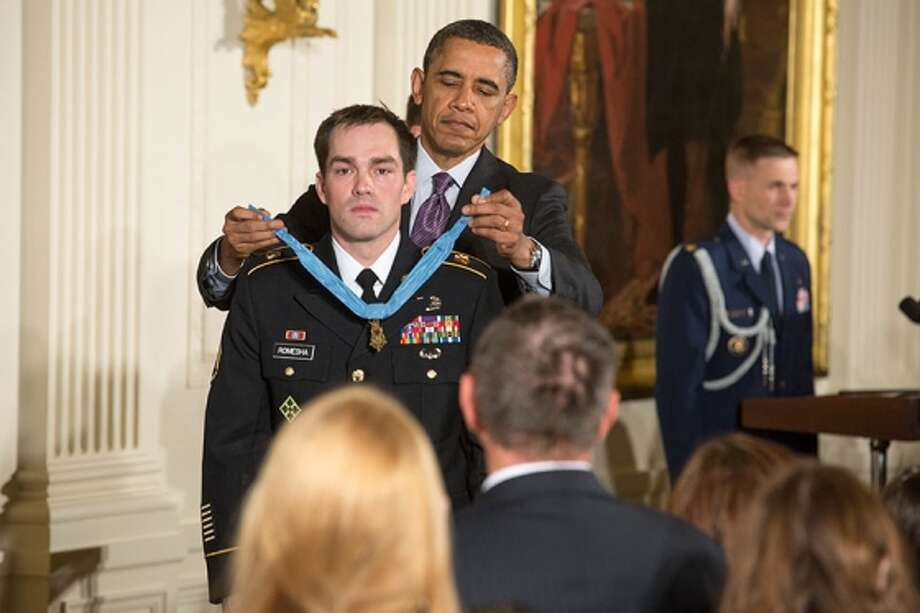 President Barack Obama awards Staff Sgt. Clinton Romesha the Medal of Honor for conspicuous gallantry, during a ceremony in the East Room of the White House, Feb. 11. Photo: Official White House Photo By Chuck Kennedy