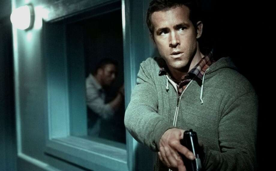 "Ryan Reynolds makes ""Safe House"" much better to look at."