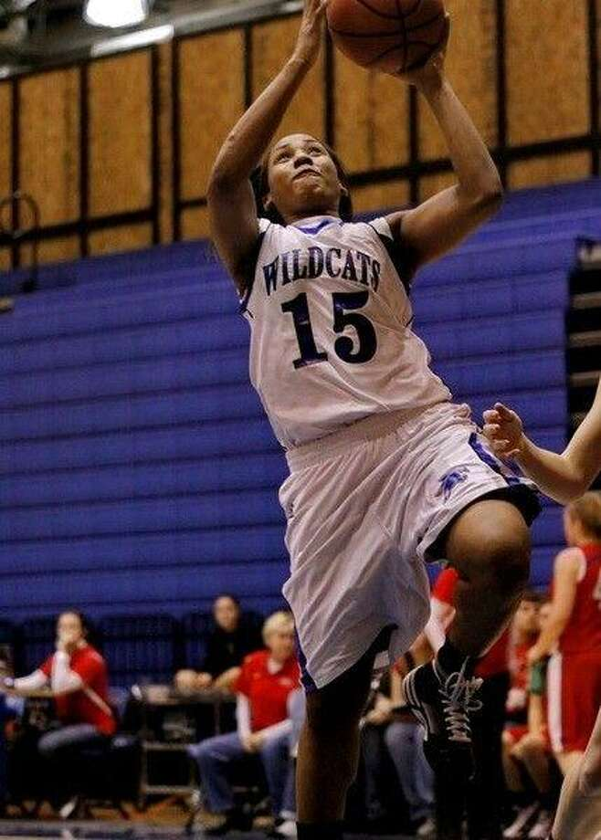 Alexis Durley led the Lady Wildcats with 32 points in their win over Tomball. (Photo by KJWESPHOTOS.COM)