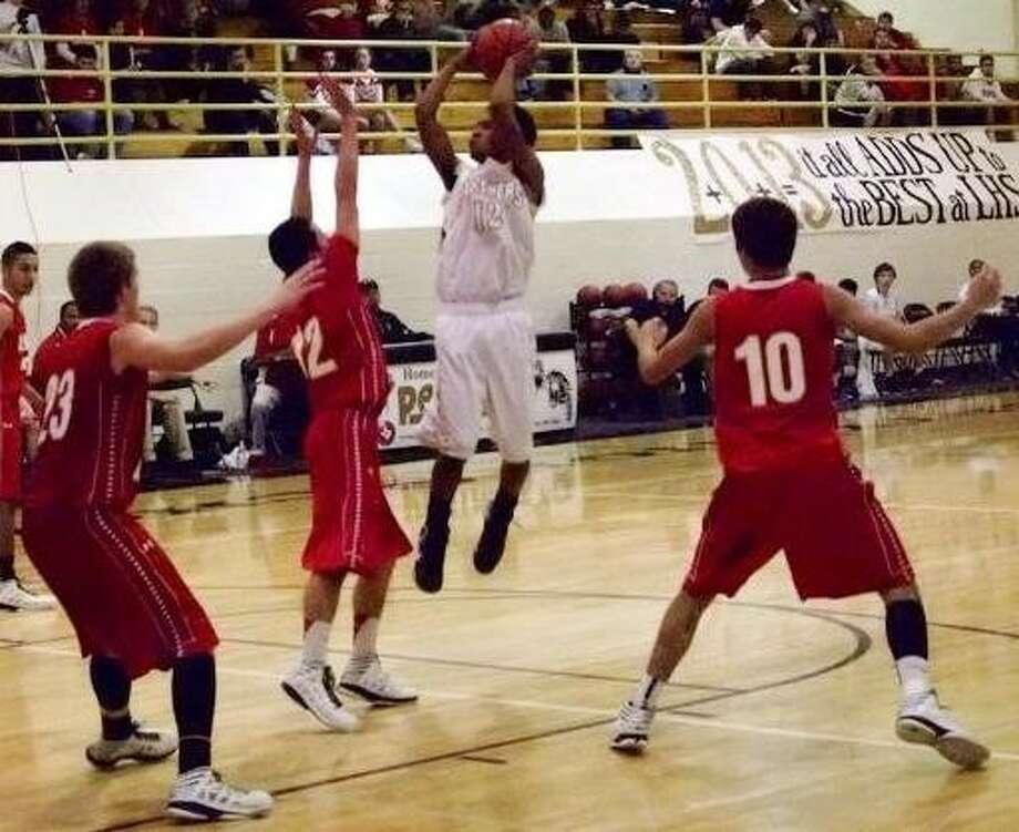 Jordan Jones, Liberty's high scorer in the game against Splendora, makes a jump shot. The final score was 60-55, Splendora. Photo: CASEY STINNETT