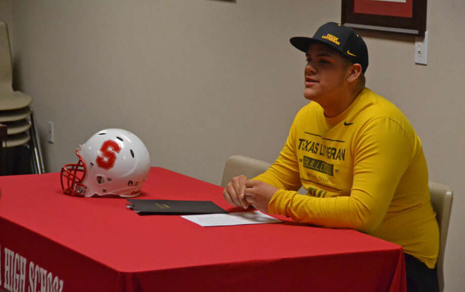 Splendora's Taylor Whitmire signed a National Letter of Intent play football for Texas Lutheran University at a ceremony on Feb. 6, 2013. Photo: Photo By Stephen Whitfield
