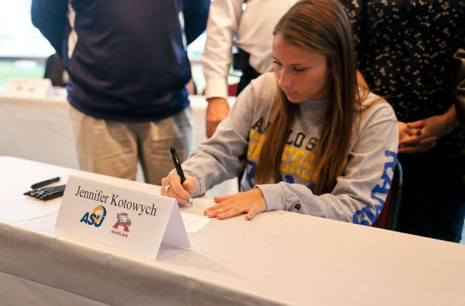 Jennifer Kotowych signs a National Letter of Intent to play soccer for Angelo State University on Feb. 6, 2013, at the Humble ISD Signing Day Ceremony at the Humble Civic Center. Photo: Photo By Amanda J. Cain
