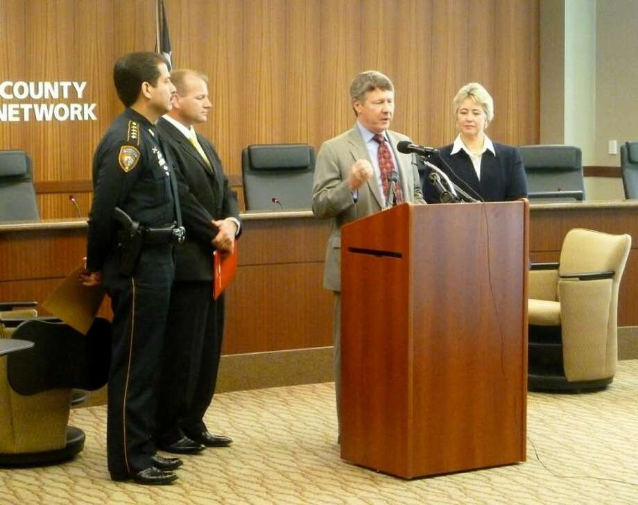 Harris County Judge Ed Emmett, Houston Mayor Annise Parker, Fort Bend Sheriff Troy Nehls and Harris County Sheriff Adrian Garcia urge the public to sign up for GHC 9-1-1 Emergency Network's text alerts.