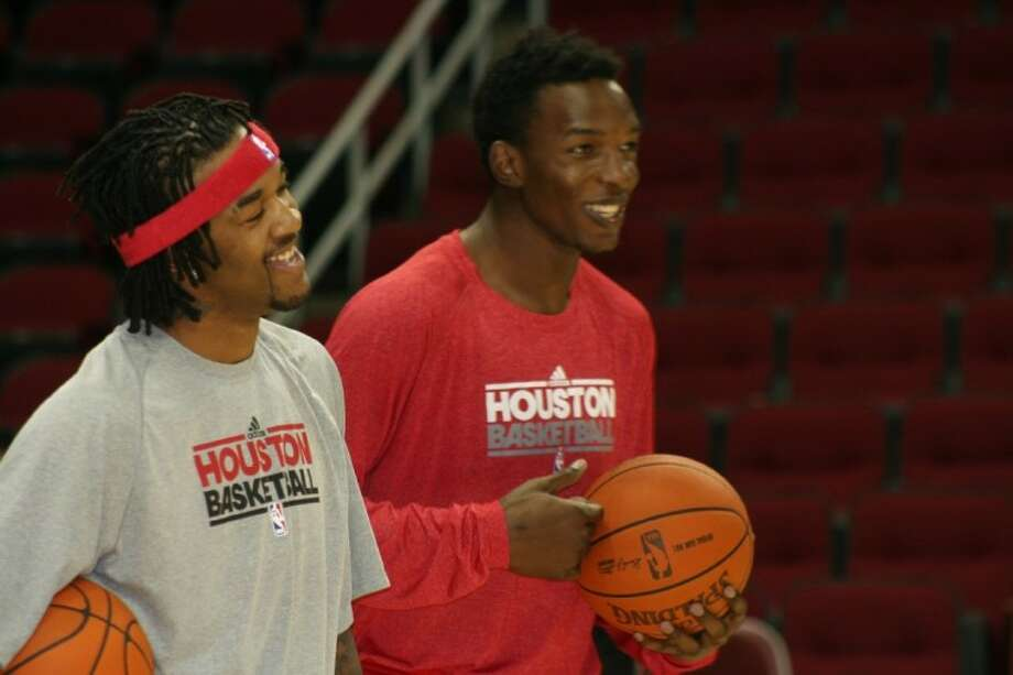 Houston Rockets center Hasheem Thabeet, right, shares a laugh with teammate Jordan Hill before the Rockets' victory over Charlotte. Thabeet is a 2006 Cy Christian High graduate.