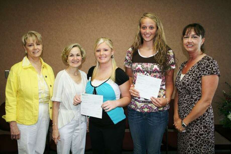 Two Tarkington High School students, Samantha Martin and Courtney Holmes, are presented with $1,000 scholarships from representatives of the Dr. William L. Barnett Scholarship Foundation. Pictured left to right are Carolyn McWaters, Cleveland Mayor Jill Kirkonis (daughter of Dr. Barnett), Holmes, Martin and Amber Kincaid with Cleveland Regional Medical Center.