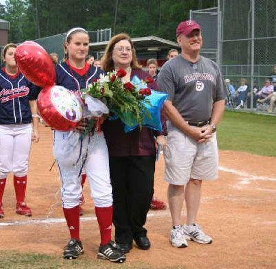 Stephanie Regan, left, poses with mother, Sue, and father, John, during the Atascocita softball team's Senior Night April 24.