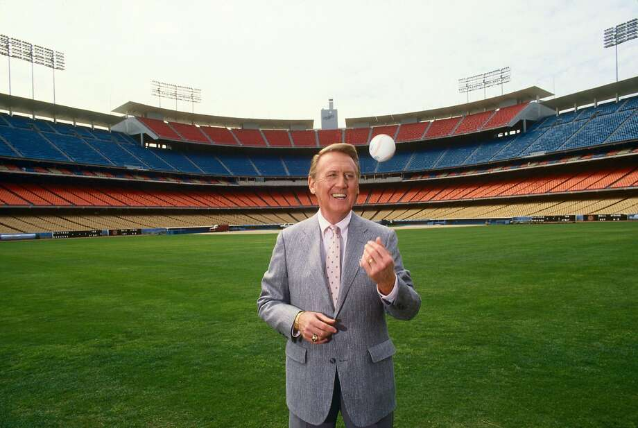Voice of the Los Angeles Dodgers radio broadcasts, Vin Scully, poses in the outfield of Dodger Stadium during a 1990 Los Angeles, California, photo portrait session. (Photo by George Rose/Getty Images) Photo: George Rose, Getty Images