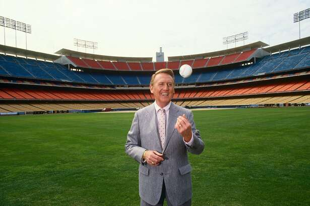 LOS ANGELES, CA - 1987: Voice of the Los Angeles Dodgers radio broadcasts, Vin Scully, poses in the outfield of Dodger Stadium during a 1990 Los Angeles, California, photo portrait session. (Photo by George Rose/Getty Images)