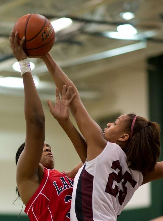 Cinco Ranch's Taylor Williams blocksRangie Bessard's shot during the Cougars' bi-district playoff game against Lamar on Monday. Next up for Cinco Ranch is Elsik. Photo: Kevin B Long