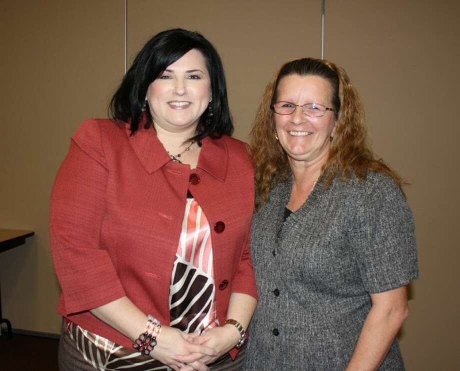 Sonia Calloway, right, a certified public accountant, discussed recent legislative changes affecting tax rates with members of the Greater Cleveland Chamber of Commerce on Feb. 7. Shown on the left is chamber CEO Tracey Walters. Photo: MELECIO FRANCO