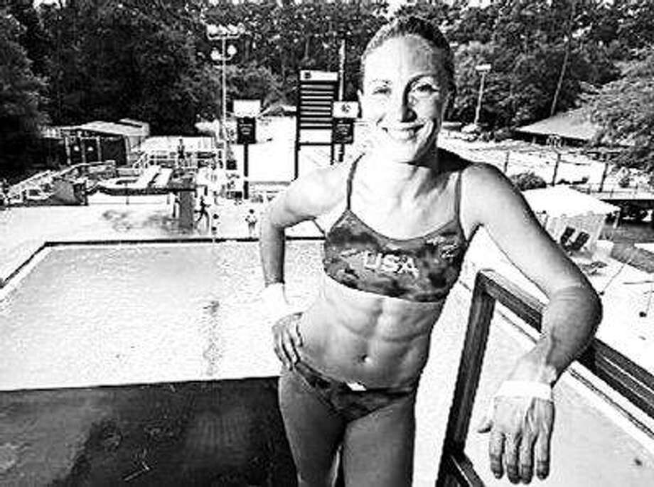 Laura Wilkinson pauses for a moment during her final workout at the Woodlands Athletic Club before flying to Beijing to compete in the 2008 Olympic Games. / @WireImgId=376283