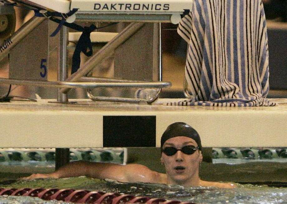 The Woodlands' Canon Clifton looks at the board for his time after the Boys 100-yard freestyle event during Saturday's 5A Regional Swimming & Diving championships at the CISD Natatorium in Shenandoah. To view or order this photo or others like it, visit: HCNPics.com