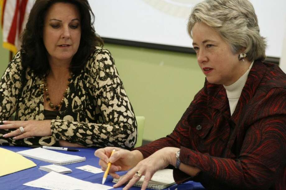 """City of Houston Mayor Annise Parker, right with liaison Gwendolyn Condoleo speak with a resident during the """"Three Minutes with the Mayor"""" neighborhood office hours Feb. 11."""