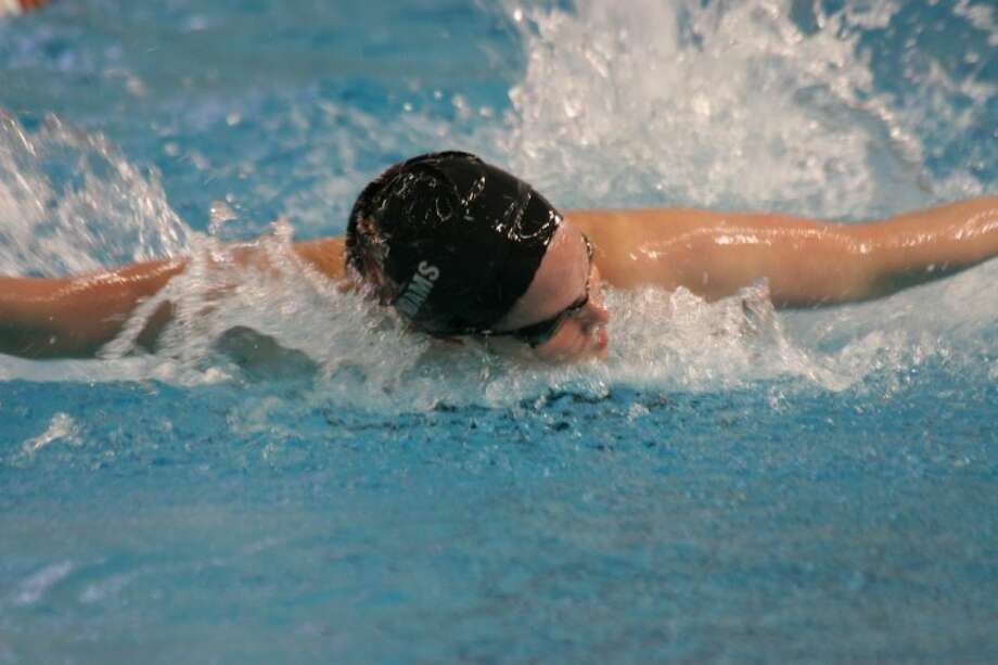 Texas A&M freshman Cammile Adams, a 2010 Cy Woods High graduate, finished second in the 200 Butterfly on Saturday at the NCAA Division I Championships in Austin. (Photo by LIZ DITTMER/TEXAS A&M ATHLETICS)