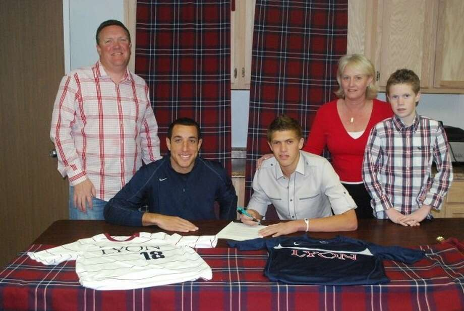Tomball senior Jack Hayes signed a soccer scholarship with Lyon College in Batesville, Ark. Also pictured are Lyon coach Mitch McKay (seated, left), parents Martin and Karen Hayes and brother Jamie Hayes.
