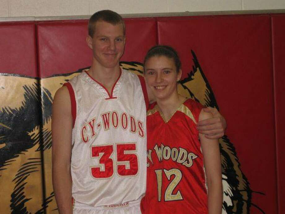 Cy Woods High senior center Carter Nash, left, and his sister, Cy Woods High junior guard Jenny Nash, start for their respective CWHS boys basketball teams. Carter and the CWHS boys team are 7-1 in district competition; Jenny and the CWHS girls team have a district record of 7-3.