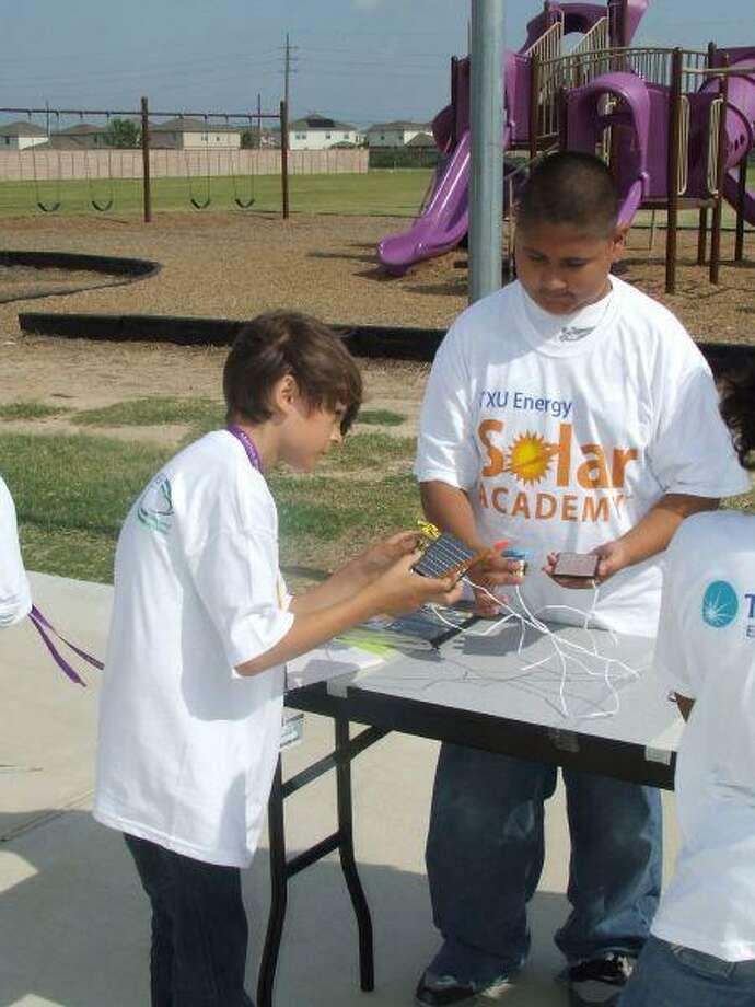 Morton Ranch students examine solar cells.