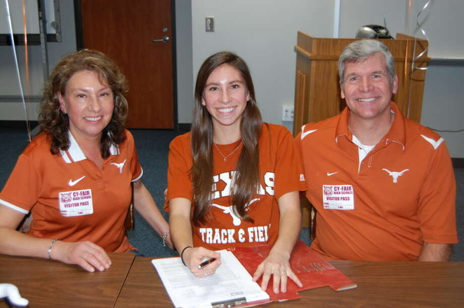 Cy-Fair cross country standout Lauren Fritz's signing with Texas for track and cross country. She is with parents Julie and Eric Fritz.