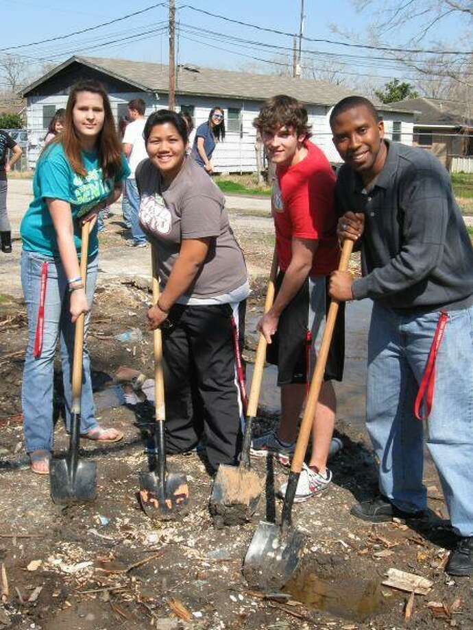 Members of Dulles PALS at ground breaking for Fort Bend Corps Hearts and Hammers home for FBISD employee, include, l-r, Loren Schuster, Stacie Cenal, Luke Yanker and Clement Agho-Otoghile.