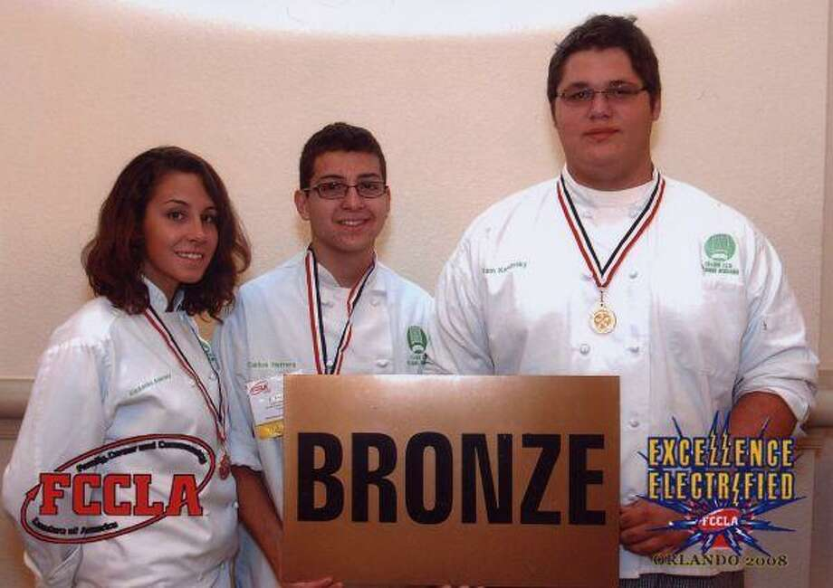 The trio displays their bronze medal. Pictured from left to right are Ali Ankney, Carlos Herrera and Samuel Kaminsky.