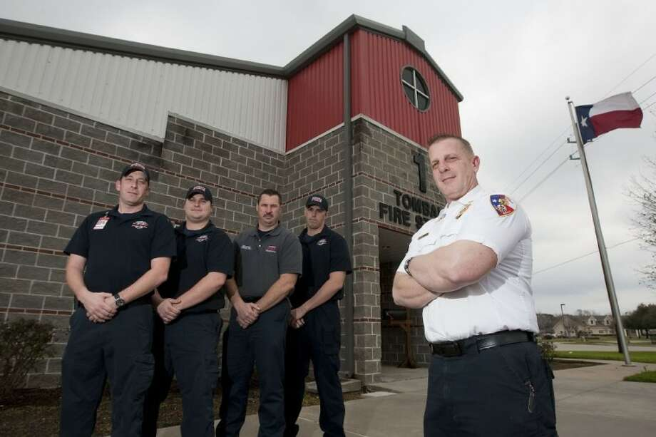 Assistant Fire Chief John Fontenot stands with fire fighters in front of Tomball's Fire Station 1. The department is hopeful it will receive a grant to help add additional paid firefighters in the coming year. Photo: Karl Anderson