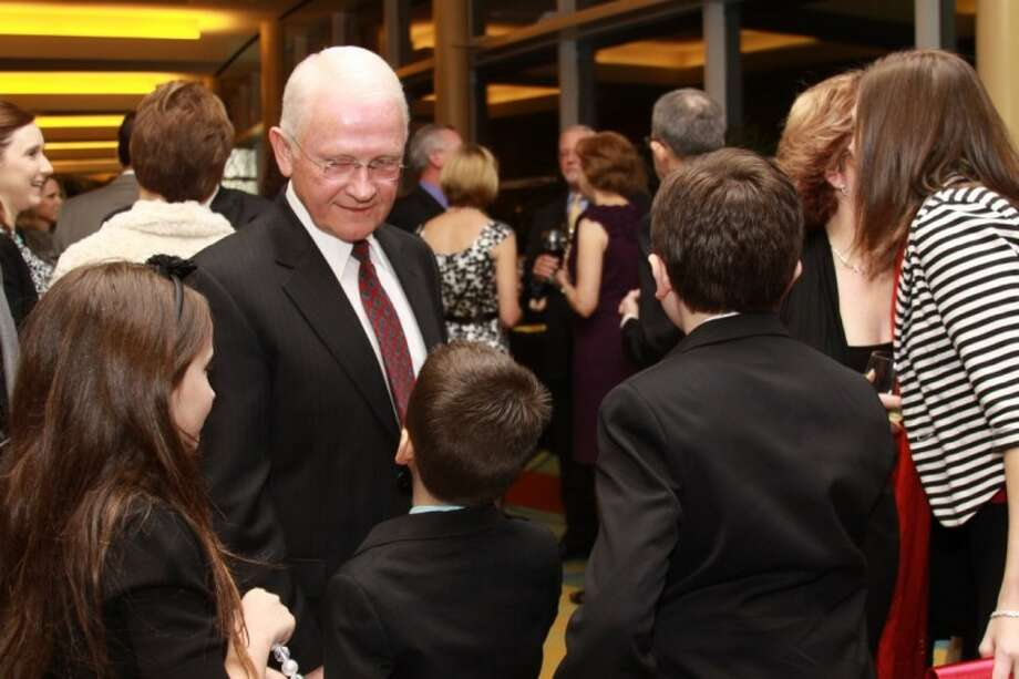 Precinct 3 Commissioner Ed Chance visits with his grandchildren during a tribute event in his honor Saturday night.