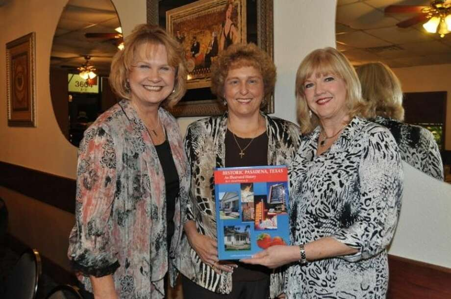 "the latest Pasadena Historical book ""Historic Pasadena Texas""was on display at the dinner meeting. Enjoying the book are from lift Dr. Jan Wheeler and Shelley Fuller, Project Joy and Hope and Carol McGee Arnold President of the Pasadena Historical Society. Photo: JACKIE WELCH"