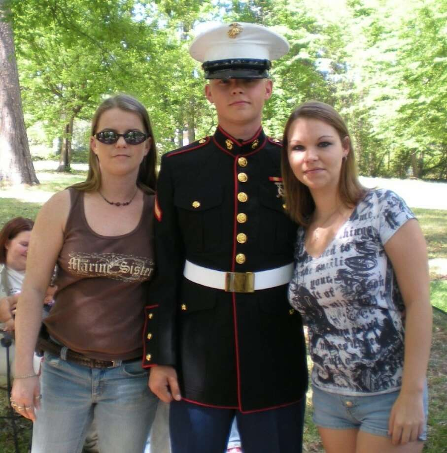 USMC Lance Corporal Robert Clements, 22, shown with his sisters, Christy Boutwell and Ashley Clements, will be returning home to Shepherd on Tuesday, Feb. 21. It will be the first time Clements has been home since he was deployed to Afghanistan in 2011. Photo: Submitted Photo