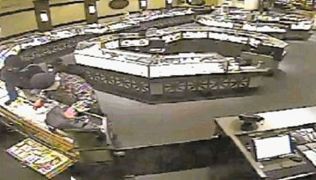 Surveillance cameras captured robbers in the act on Dec. 22 at Ben Bridge Jewelers in the crowded Galleria.