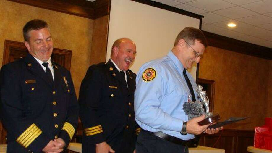 Kenneth Joffrion, Porter Firefighter of the Year, was recognized by Fire Chief Jody Binnion and Deputy Fire Chief David Teverbaugh at the Porter Fire Department's annual awards banquet Jan. 30.
