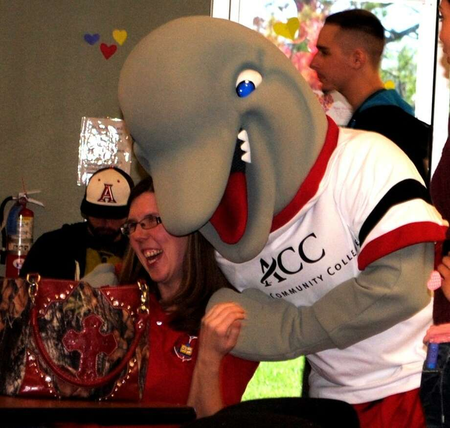 Alvin Community College mascot Blue, right, hugs ACC student April Shifflett, of Brazoria, during Valentine's Day at the ACC Student Center on Wednesday. Photo: ACC
