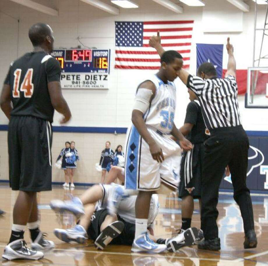 The referee signals jump ball during the opening minutes of the second period as Rayburn and Dobie players begin to untangle from a pile. Dobie's Randy Owens (14) would score nine first-half points.
