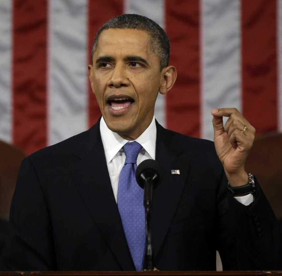 President Barack Obama gestures as he gives his State of the Union address during a joint session of Congress on Capitol Hill in Washington, Tuesday Feb. 12, 2013.