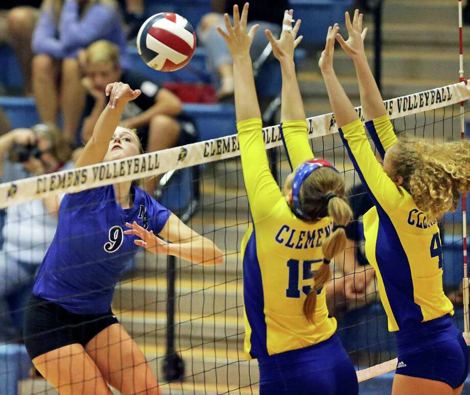 New Braunfels' Shelby Tate (from left) hits the ball past host Clemens' Shelby O'Neal and Mackenzie Miller on Tuesday. Photo: Tom Reel / San Antonio Express-News / 2016 SAN ANTONIO EXPRESS-NEWS