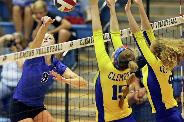 New Braunfels' Shelby Tate (from left) hits the ball past host Clemens' Shelby O'Neal and Mackenzie Miller on Tuesday.