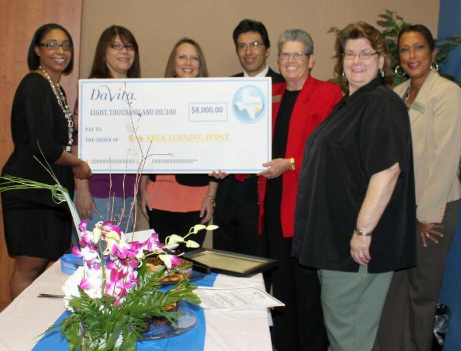 Some of DaVita's Houston clinics present a check for 8,000 to Bay Area Turning Point. From left to right, Chakilla Robinson, DaVita; Norma Ashmawee, DaVita; Jodi West, DaVita; James Briones, DaVita; Maria Longnecker, Bay Area Turning Point; Sally Armstrong, DaVita; and Sheryl Dickerson, Bay Area Turning Point. Photo: Submitted Photo