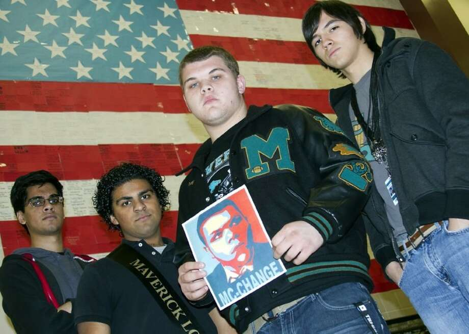 "Candidate Mark McNeil displays his iconic ""McChange"" poster, with his filmmaker colleagues Jonathan Griffin, Josiah Sandhu and Faraz Mohammed. Photo: AL CARTER"