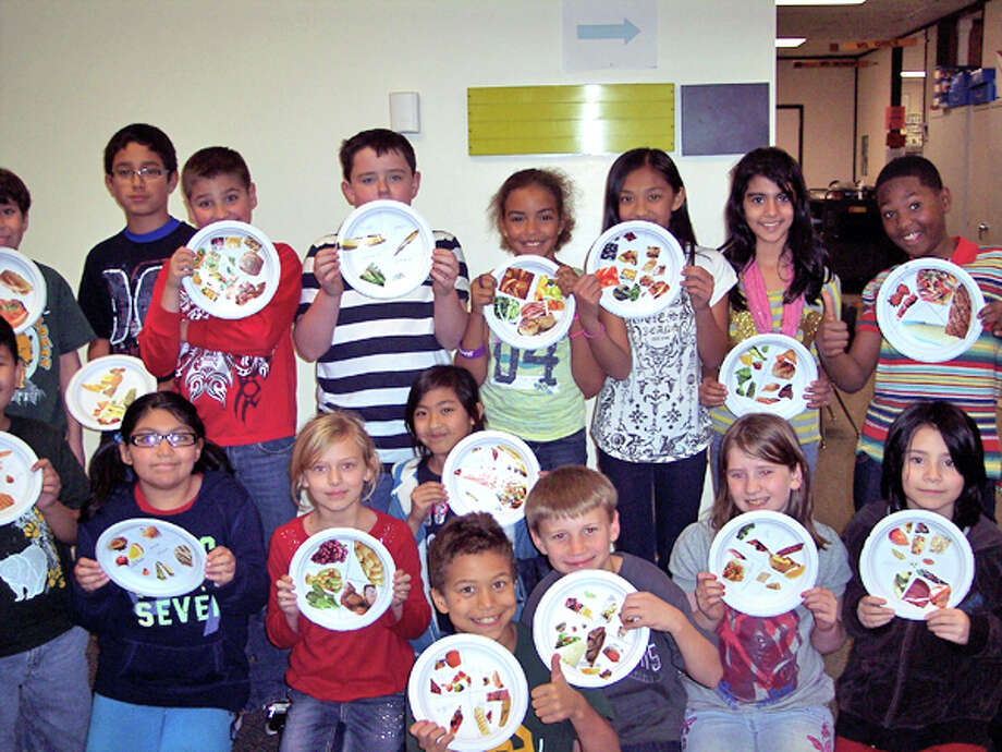 Greenwood Forest fourth graders make portion plates at the Super Bowl of Fitness event.