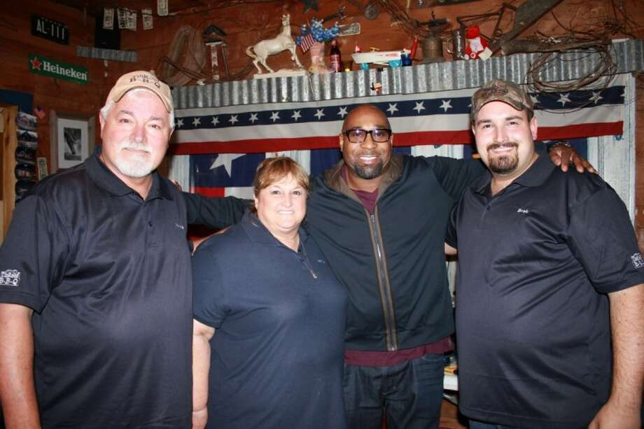 "New television show ""Roadtrip with G. Garvin,"" featuring Chef G. Garvin, second from right, who travels around the country visiting and cooking at special restaurants, will debut by featuring Tin Roof BBQ, owned by Ronnie and Nancy Webber with son Brek Webber. The restaurant will be featured on the first episode in late May to early June."