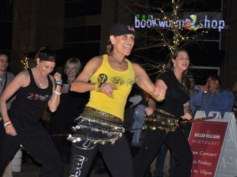 Zumba instructors from area health clubs led dances for a packed crowd at the Keller Williams concert at Kings Harbor Jan. 22. From left are Chari Paulson, Kingwood Athletic Club; Velia Abdala, Zumba with Velia; and Melissa Reaux Dismukes, Halliburton Corporate Gym.