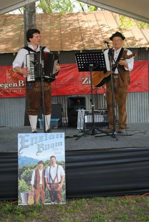 """Eddie and Jason of Enzian Buam performed at the Tomball German Heritage Festival previously. Every year, on the last weekend in March, festival-goers in Tomball break out their Lederhosen and Dirndls and """"Go German"""" for the area's largest festival celebrating the heritage of the original German families who settled this area beginning in about 1840. Photo: Anna Schumann"""