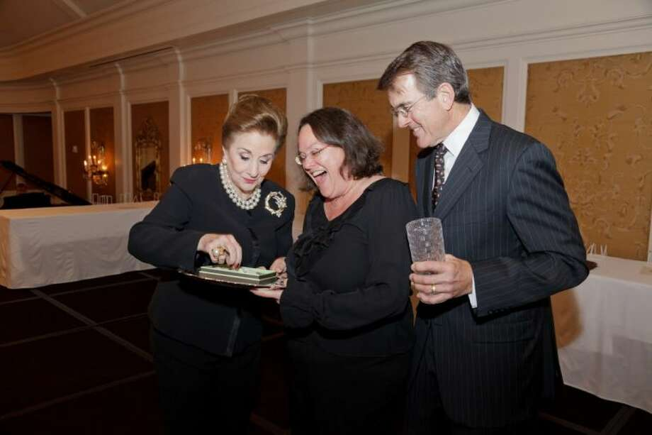 Martha Turner (left) and Tom Anderson present top producer Lisa Baer with a Diamond Necklace at Martha Turner Properties annual Circle of Excellence Awards Breakfast.