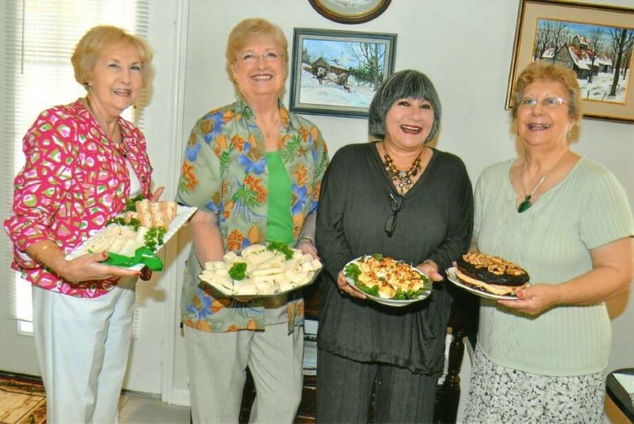 """Pasadena's """"Dutchess of Tea"""" Sylvia Fritsch, right, held her annual tea for former students on March 16. Sylvia now resides in San Leon. Pictured from left are Bea Glassco, Ann Doucet, Velma Bailey and Sylvia Fritsch."""