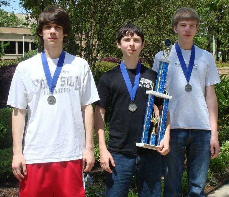 FHS programmers Ben Braun, Chris Cotter and Andrew Wiley with the first place trophy from the State TCEA High School Programming meet.