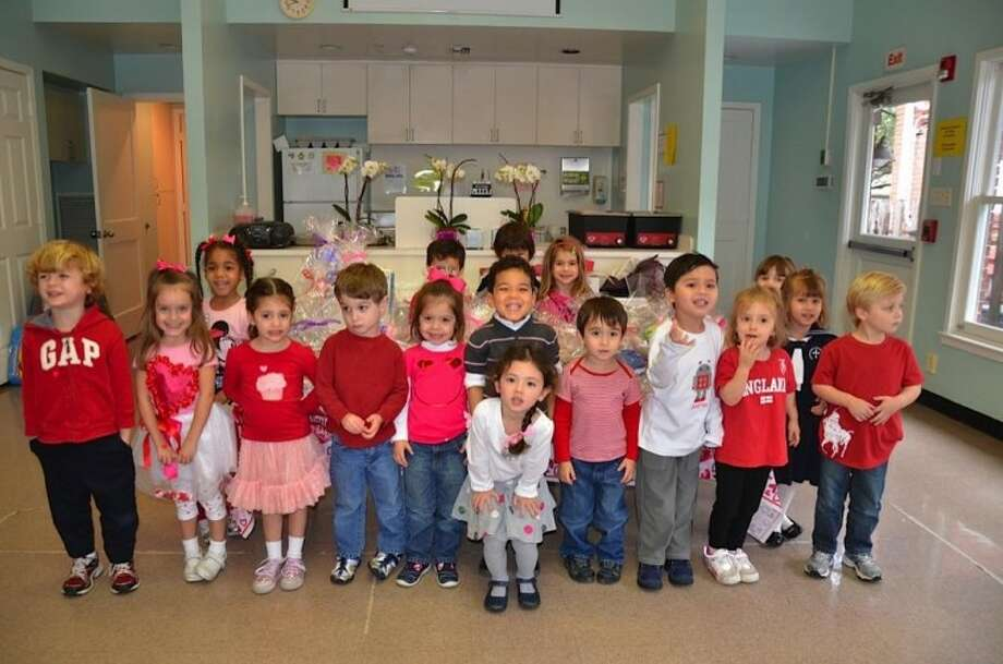 """Early Childhood students in Mrs. Lucy DiNunzio and Miss Sarah Schmidt class celebrate """"AOS Has a Heart Day."""" (Photo submitted by Annunciation Orthodox School)"""