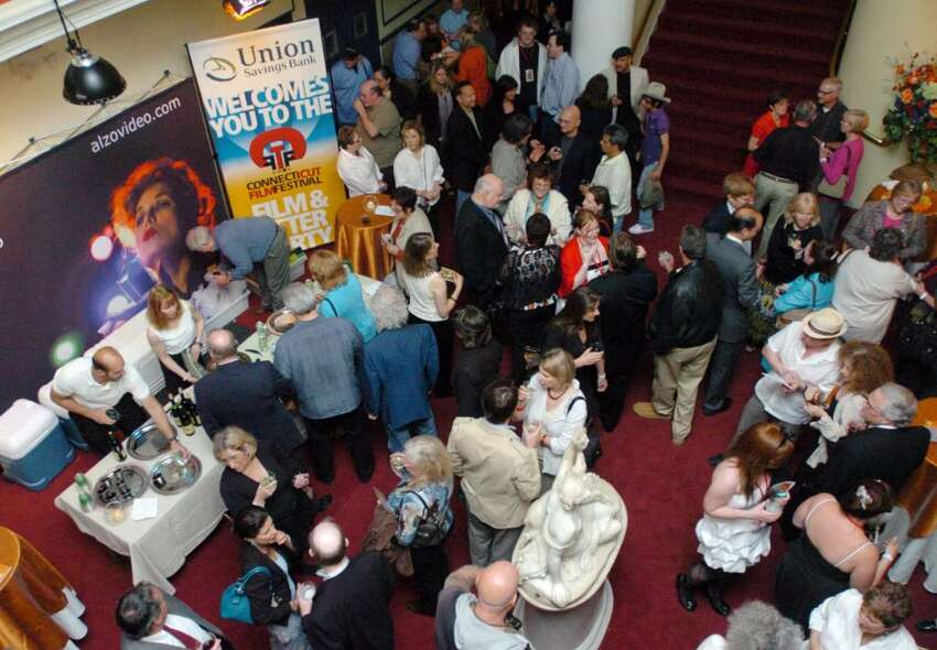 Patrons congregate in the lobby of the Palace Theater in Danbury Tuesday, May 4, 2010 on opening night of the sixth annual Connecticut Film Festival