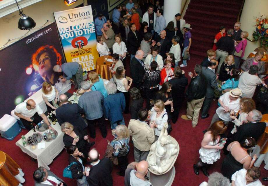 Patrons congregate in the lobby of the Palace Theater in Danbury Tuesday, May 4, 2010 on opening night of the sixth annual Connecticut Film Festival Photo: Chris Ware / The News-Times