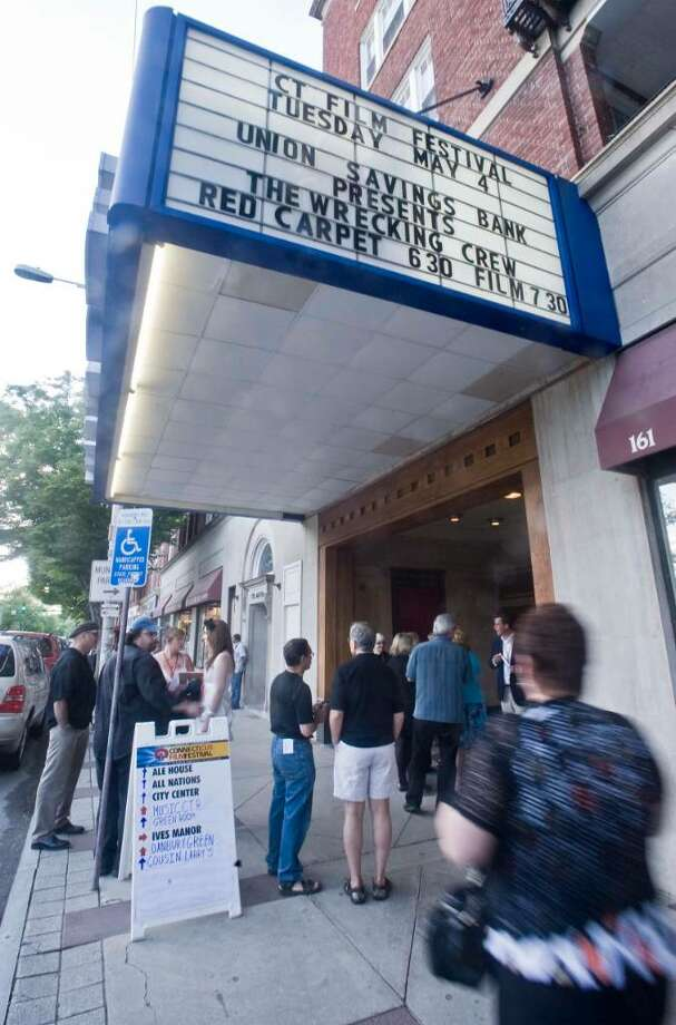 Folks gather at the entrance to the Palace Theater in Danbury prior to the start of the Connecticut Film Festival. Tuesday, May 4, 2010 Photo: Scott Mullin / The News-Times Freelance