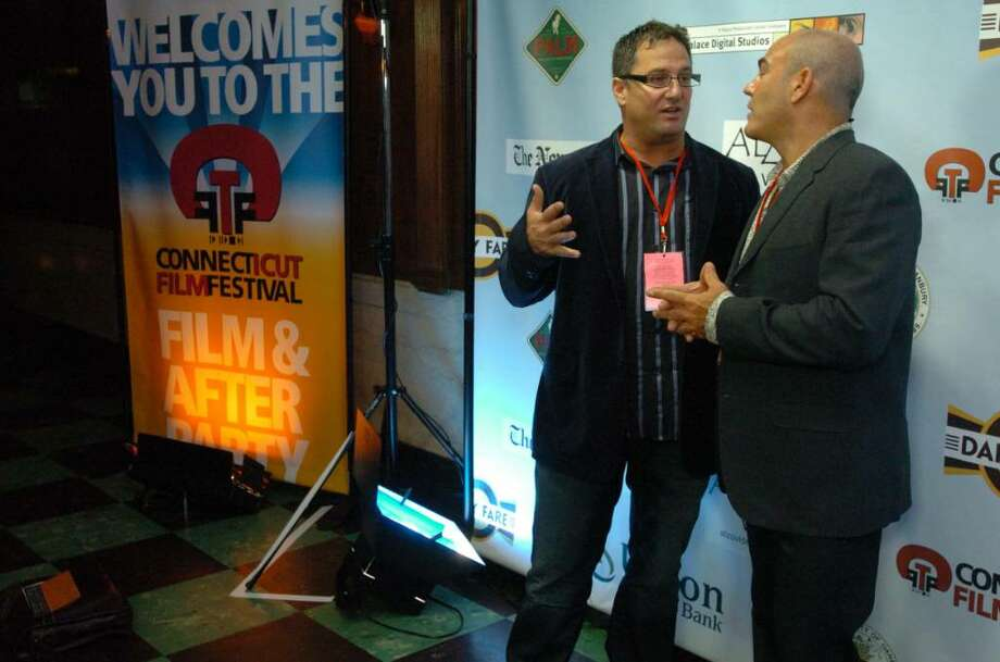 Director Denny Tedesco, left, and Steve di Costanzo of WPKN in Bridgeport speak at the beginning of the Connecticut Film Festival at the Palace Theater in Danbury Tuesday, May 4, 2010. Photo: Chris Ware / The News-Times