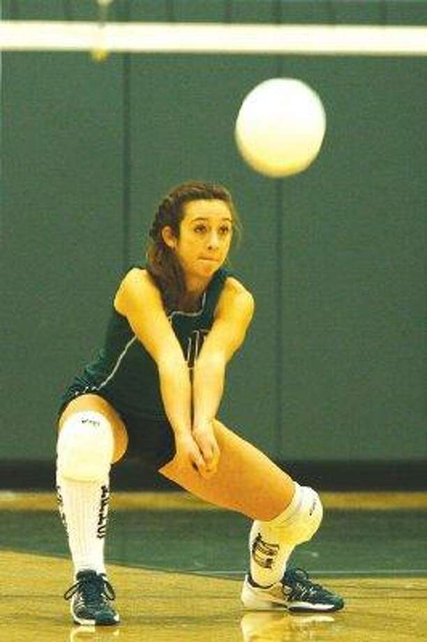 Kingwood Park's Rachel Doyle squares up to pass last year against Cleveland Tarkington. / @WireImgId=374041